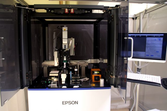 The ink discharge test is conducted using an inkjet machine for R&D equipped with Epson's PrecisionCore printhead.